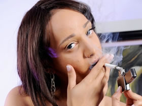 shemale girl Sunshyne Monroe smokes and undresses