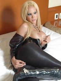 stunning blonde shemale Milla Viasotti in black leather